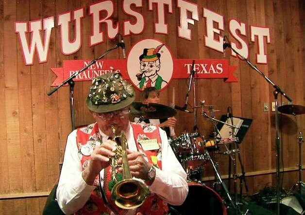 Gordon Zunker, foreground, plays in the Cloverleaf Orchesta at Wurstfest in New Braunfels, Texas on Wednesday, November 7, 2007. Zunker has played in the band for over 50 years and at every Wurstfest since it opened 47 years ago. Zunker will be retiring his trumpet after this year. (Kin Man Hui/Staff) Photo: KIN MAN HUI, SAN ANTONIO EXPRESS-NEWS / SAN ANTONIO EXPRESS-NEWS