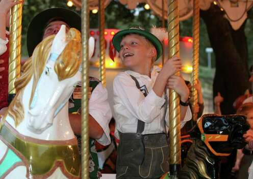 ** FOR IMMEDIATE RELEASE **This November 2006 photo provided by the Wurstfest Association of New Braunfels shows a young boy in traditional dress on the carousel at Wurstfest, an annual German festival held in New Braunfels, Texas. Photo: K. Jessie Slaten, AP / Wurstfest Association of New Bra