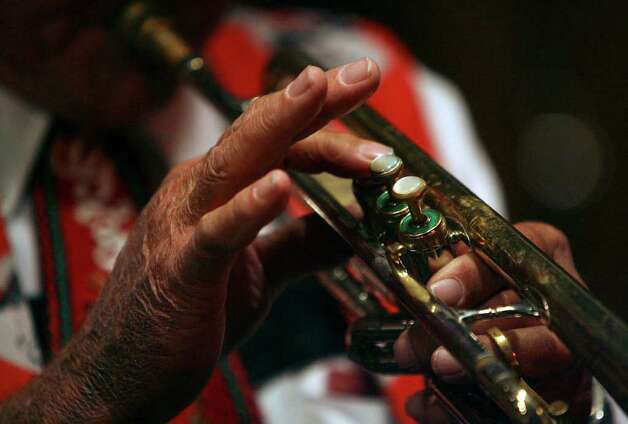 The deft fingers of Gordon Zunker,75, control the valves of his trumpet while playing with the Cloverleaf Orchestra at Wurstfest in New Braunfels, Texas on Wednesday November 7, 2007. After 50 years with the group, Zunker says he's ready to retire.   JOHN DAVENPORT / STAFF Photo: JOHN DAVENPORT, SAN ANTONIO EXPRESS-NEWS / SAN ANTONIO EXPRESS-NEWS