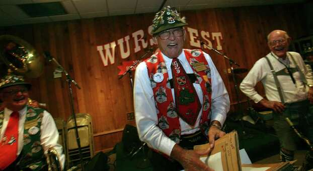 Gordon Zunker (center) shares a laugh with fellow musicians at Wurstfest in New Braunfels, Texas on Wednesday November 7, 2007. Zunker,75, has played at all of the 47 Wurstfests with the Cloverleaf Orcherstra and will retire after this year's celebration. JHOHN DAVENPORT / STAFF Photo: JOHN DAVENPORT, SAN ANTONIO EXPRESS-NEWS / SAN ANTONIO EXPRESS-NEWS