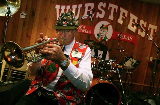 Gordon Zunker,75, plays the trumpet at Wurstfest with the Cloverleaf Orchestra on Wednesday November 7, 2007 in New Braunfels, Texas. Zunker has played trumpet with the Cloverleaf Orchestra for 50 years and is going to retire. JOHN DAVENPORT / STAFF Photo: JOHN DAVENPORT, SAN ANTONIO EXPRESS-NEWS / SAN ANTONIO EXPRESS-NEWS