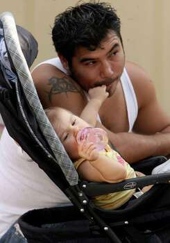 METRO -- David Ozuna and his daughter Sol Lee Ozuna (cq) 9 months at Wurstfest in New Braunfels Sunday November 04, 2007. Photo: Robert McLeroy, San Antonio Express-News / San Antonio Express-News
