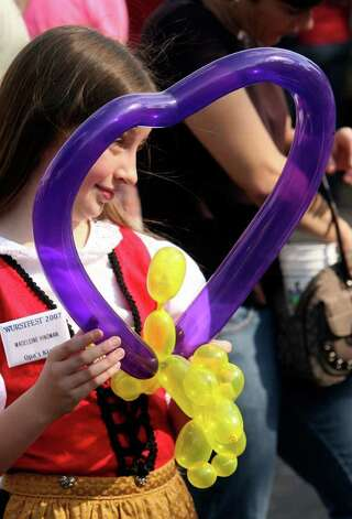 METRO -- Madeline Hindman, 8, has a new balloon at Wurstfest in New Braunfels Sunday November 04, 2007. Photo: Robert McLeroy, San Antonio Express-News / San Antonio Express-News