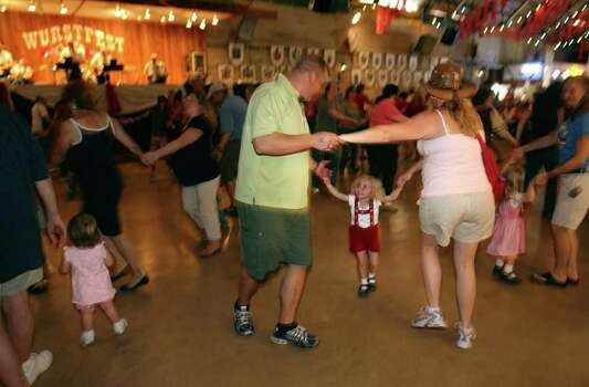 METRO -- (left to right) Rich, Grayton (cq) 3 years; and Lee Hale dance as a family at Wurstfest in New Braunfels Sunday November 04, 2007. Photo: Robert McLeroy, San Antonio Express-News / San Antonio Express-News