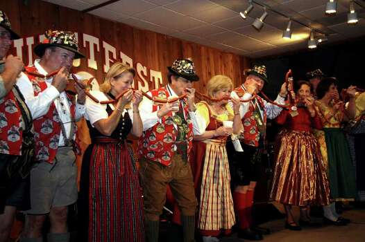 "** FOR IMMEDIATE RELEASE **This November 2006 photo provided by the Wurstfest Association of New Braunfels shows the annual ""biting of the sausage,"" which kicks off Wurstfest, an annual German festival held in New Braunfels, Texas. Photo: K. Jessie Slaten, AP / Wurstfest Association of New Braunfels"