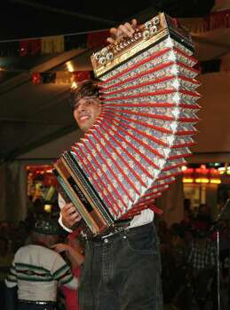 ** FOR IMMEDIATE RELEASE **This November 2006 photo provided by the Wurstfest Association of New Braunfels shows a young man playing the accordion as the entertainment at Wurstfest, an annual German festival held in New Braunfels, Texas. Photo: K. Jessie Slaten, AP / Wurstfest Association of New Braunfels
