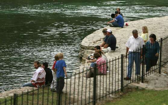 METRO -- Participants at Wurstfest in New Braunfels slow down along the Comal River away from the center of activities.  Sunday November 5, 2006. Photo: ROBERT MCLEROY , SAN ANTONIO EXPRESS-NEWS / San Antonio Express-News