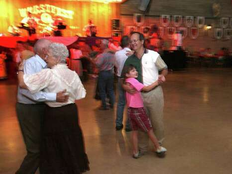 METRO -- Audrey Godwin, 8, dances with her dad Mike Godwin (both of Austin) to the sounds of a live band in the Wursthalle at Wurstfest in New Braunfels Sunday November 5, 2006. Photo: ROBERT MCLEROY , SAN ANTONIO EXPRESS-NEWS / San Antonio Express-News