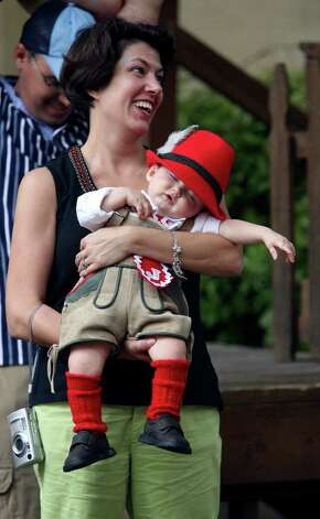 METRO -- Kristi Lindsay (cq) carries her son,   Jadon Linsday, 11 months (cq) at Wurstfest in New Braunfels Sunday November 5, 2006. Photo: ROBERT MCLEROY , SAN ANTONIO EXPRESS-NEWS / San Antonio Express-News