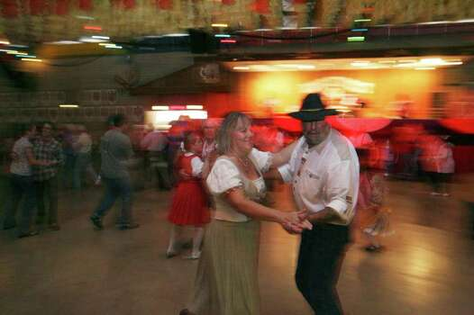 METRO -- Pam and Bill Darby, of Odessa,  dance to the sounds of a live band in the Wursthalle during Wurstfest in New Braunfels Sunday November 5, 2006. Photo: ROBERT MCLEROY , SAN ANTONIO EXPRESS-NEWS / San Antonio Express-News