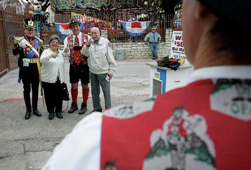 METRO      -----    Laila Rizkalla and her husband Joseph Rizkalla of Houston pose Saturday afternoon Nov. 4, 2006 in New Braunfels for a picture with James H.G. Thompson and Dan Krueger at Wurstfest in New Braunfels.        (WILLIAM LUTHER/STAFF) Photo: WILLIAM LUTHER, SAN ANTONIO EXPRESS-NEWS / San Antonio Express-News