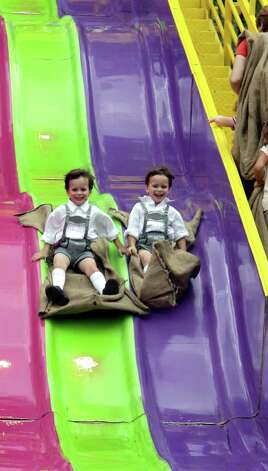 METRO -- Twins Nicholas and Christopher Vallance, 5, of San Antonio slide together during Wurstfest in New Braunfels Sunday November 5, 2006. Photo: ROBERT MCLEROY , SAN ANTONIO EXPRESS-NEWS / San Antonio Express-News
