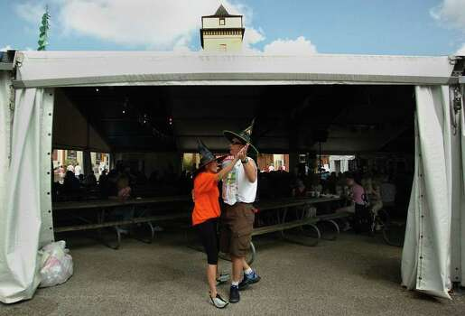 METRO - Dan McQuillen (right) and his wife, Tammy, of Houston, Texas dance to polka music at Wurstfest on Saturday, October 30, 2004. The couple donned witches hats in spirit of Halloween. The event is a celebration of music, food and drink. (Kin Man Hui/staff) Photo: KIN MAN HUI, SAN ANTONIO EXPRESS-NEWS / SAN ANTONIO EXPRESS-NEWS
