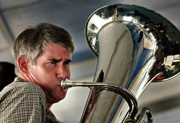 METRO DAILY - Mike Barker of the band Alpenfest from Houston, plays the tuba with his band at Wurstfest in New Braunfels, Saturday, Nov. 1, 2003.  photo Bob Owen Photo: BOB OWEN, SAN ANTONIO EXPRESS-NEWS / SAN ANTONIO EXPRESS-NEWS