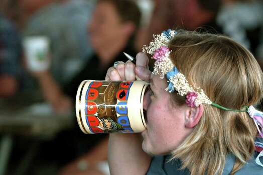 METRO DAILY - Jonna Beck drinks from her Wurstfest beer mug at Wurstfest in New Braunfels, Saturday, Nov. 1, 2003.  photo Bob Owen Photo: BOB OWEN, SAN ANTONIO EXPRESS-NEWS / SAN ANTONIO EXPRESS-NEWS