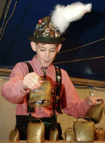 METRO:  Ten-year-old Matthew Barker plays the cowbells at Wurstfest in New Braunfels with the band Alpenfest Saturday, Nov. 2, 2002.  (KAREN L. SHAW/STAFF) Photo: KAREN L. SHAW, SAN ANTONIO EXPRESS-NEWS / SAN ANTONIO EXPRESS-NEWS