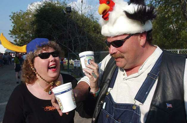 Metro  Cindy and James Hiebert,  wearing festive headgear, celebrate at Wurstfest Saturday afternoon.  Photo by Tom Reel November 10 Photo: TOM REEL , EN / EN