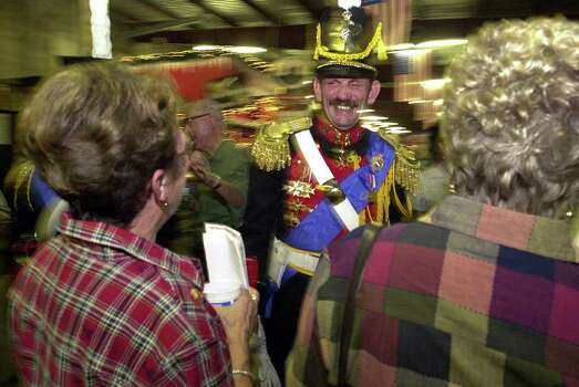 FOR METRO:  NEW BRAUNFELS:  Jodie Thompson, of Arlington, Texas, dressed in a replica of the uniform worn by the Bavarian Royal Guards until 1910, jokes with revelers at Wurstfest 2001 Friday, Nov. 2, 2001 (KAREN L. SHAW/STAFF) Photo: KAREN L. SHAW, SAN ANTONIO EXPRESS-NEWS