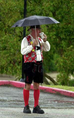 METRO DAILY - Wurstfest Opa Rick Reed seems unfazed by the rain as he sips his beer on the Wurstfest grounds Sunday, November 12, 2000 in New Braunfels. A brief, but heavy rain fell Sunday afternoon at the festival. Photo by Bahram Mark Sobhani/Special to the Express News Photo: BAHRAM MARK SOBHANI, EN / EN