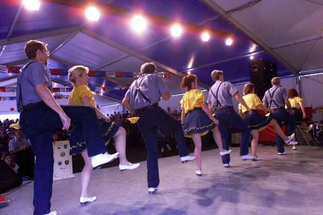 The Fire on the Mountain Cloggers dance to a full crowd at the Little Tent at the Wurstfest in New Braunfels Saturday afternoon, November 4.  Photo by Tom Reel Photo: TOM REEL