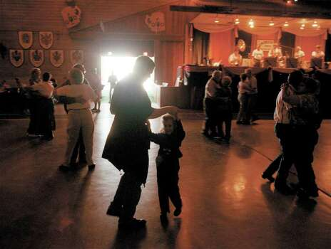 David Gibson of Dallas teaches his daughter Taylor, 6, how to waltz Saturday at Wurstfest in New Braunfels while other festival participants whirl to the sounds of the Cloveleaf Orchestra. Photo by Robin Cornett/Special to the Express-News 10-30-99 Photo: ROBIN CORNETT