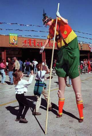 "weekenderadvance robert johnson  Gator the Clown plays ""a tall opa"" at Wurstfest.  Kids loved it.  These wanted to give him a high, high five.photo by tom reel. 11-12-96 Photo: TOM REEL, File 96-"