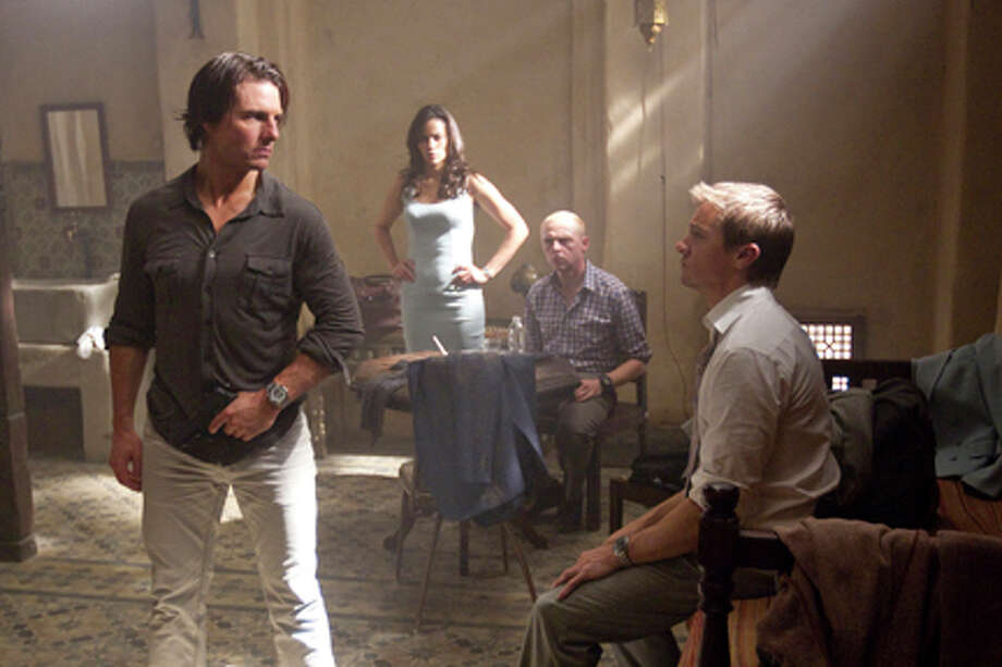 "(L-R) Tom Cruise as Ethan Hunt, Paula Patton as Jane, Simon Pegg as Benji and Jeremy Renner as Brandt in ""Mission: Impossible -- Ghost Protocol."" Photo: Photo Credit: David James / © 2011 Paramount Pictures. All Rights Reserved."