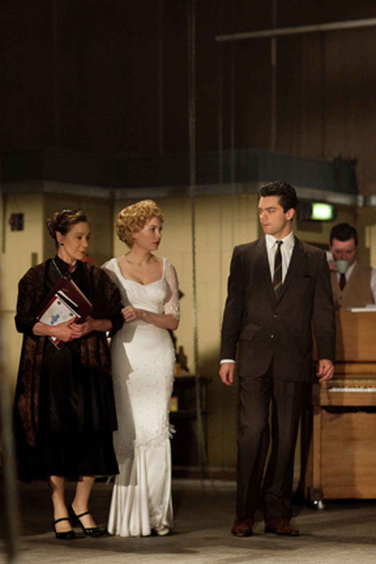 (L-R) Zoe Wanamaker as Paula Strasberg, Michelle Williams as Marilyn Monroe and Dominic Cooper as Milton Greene in