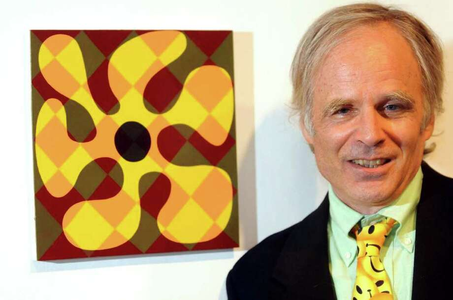 "Ken Johnson, New York Times art critic, stands by his painting entitled ""Blue Spot"" in the alumni art exhibit on Friday, Oct. 14, 2011, at UAlbany Art Museum in Albany, N.Y. Johnson wrote his first book, ""Are You Experienced,"" about the impact of 1960s psychedelia aesthetic on contemporary art. (Cindy Schultz / Times Union) Photo: Cindy Schultz / 00014934A"