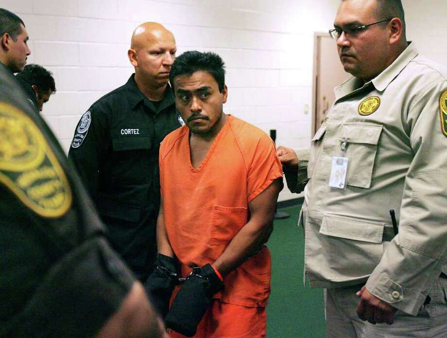 Carlos Zavala walks back to his cell after his arraignment Wednesday Nov. 2, 2011 at the Hidalgo County Detention Center in Edinburg, Texas. Zavala was charged with three counts aggravated kidnapping and two counts of attempted capital murder for a total bond of $3.5 million. Photo: AP