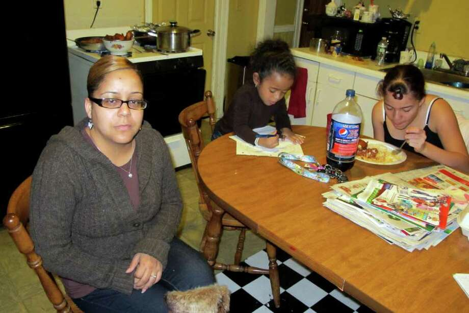 Carmelita Torres, mother of Bianca LeBron, at home in Bridgeport with her granddaughter, Nevaeha Cook, and her daughter Janissa Garcia. Bianca Lebron has been missing since November 7th, 2001 when she was last seen at the former Elias Howe School. She was 10 at the time of her disappearance. Photo: Daniel Tepfer