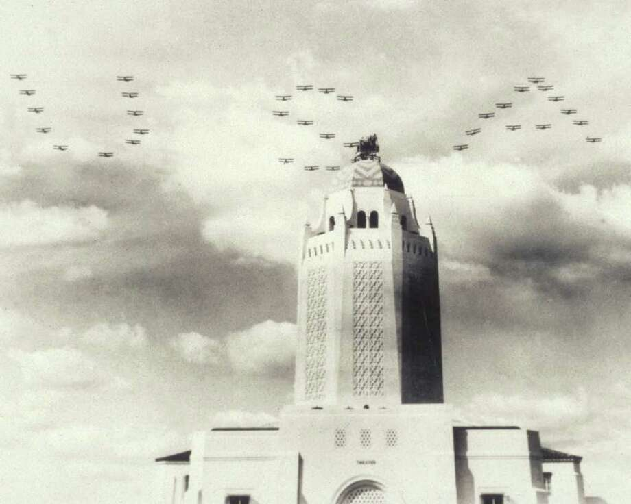"1934 photo of an actual flyover performed by bi-planes, in support of the film ""West Point of the Air, over the Taj Mahal at Randolph Air Force Base in San Antonio.  There currently is a photo making the rounds on the internet showing jets flying over in this formation. That photo is not real and appears to be based on the 1934 photo. Randolph AFB has been fielding numerous inquires via phone and email. RANDOLPH AFB/COURTESY Photo: RANDOLPH AFB, COURTESY / RANDOLPH AFB"