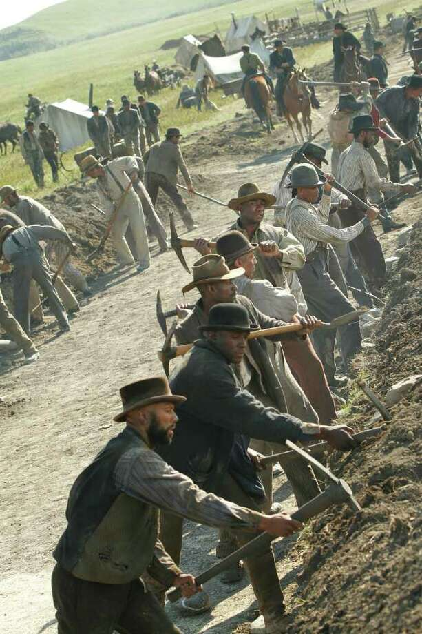 """In this image released by AMC, Common portrays Elam Ferguson, foreground, in the original series """"Hell On Wheels,"""" premiering, Sunday at 10 p.m. EST on AMC. (AP Photo/AMC, Chris Large) Photo: Chris Large / Copyright: AMC 2010"""