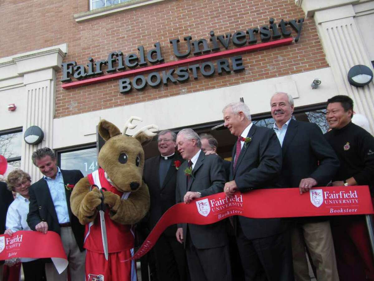 The opening of the Fairfield University Bookstore at 1499 Post Road was marked by a ribbon-cutting ceremony shortly before 11 a.m. Friday. Pictured, from left to right, are Vivien Hunicutt, a Starbuks district manager; Ken Kleban, landlord and property owner of the site; Lucas the stag; Fairfield University President Rev. Jeffrey P. von Arx, S.J.; First Selectman Michael Tetreau; Joe Skaggs, vice-president for marketing and business continuity; George Szondy, chairman of the Fairfield Chamber of Commerce; and State Representative (R-134) Tony Hwang.