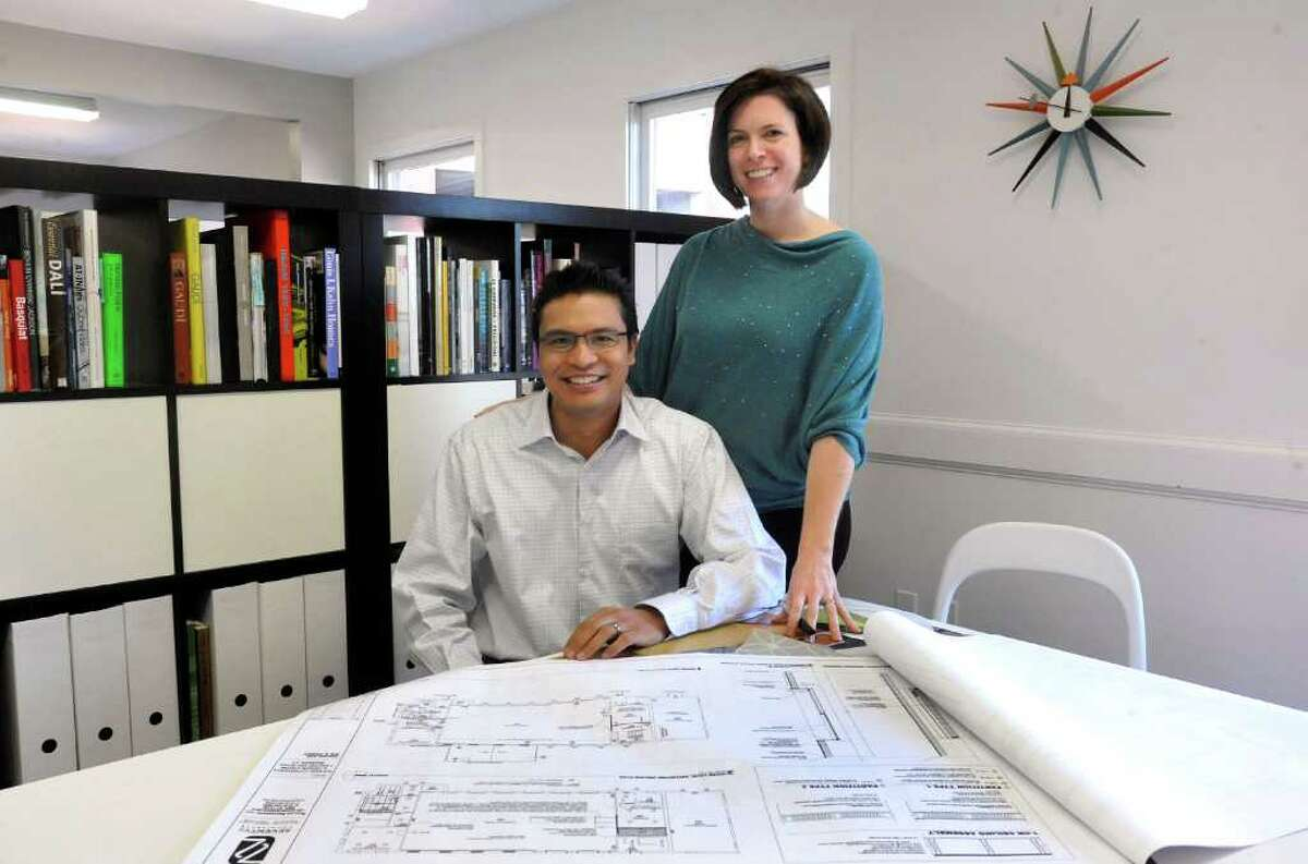 Architects Emmanuel Juan and Maura Newell Juan pose in the Danbury offices of their firm seventy2architects Friday, Nov. 4, 2011.