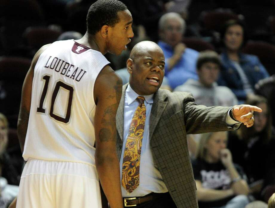 Texas A&M assistant head coach Glynn Cyprien talks with player David Loubeau (10) during the first half of an NCAA college exhibition basketball game against Dallas Baptist on Thursday, Nov. 3, 2011, in College Station, Texas. Photo: Pat Sullivan, AP / AP