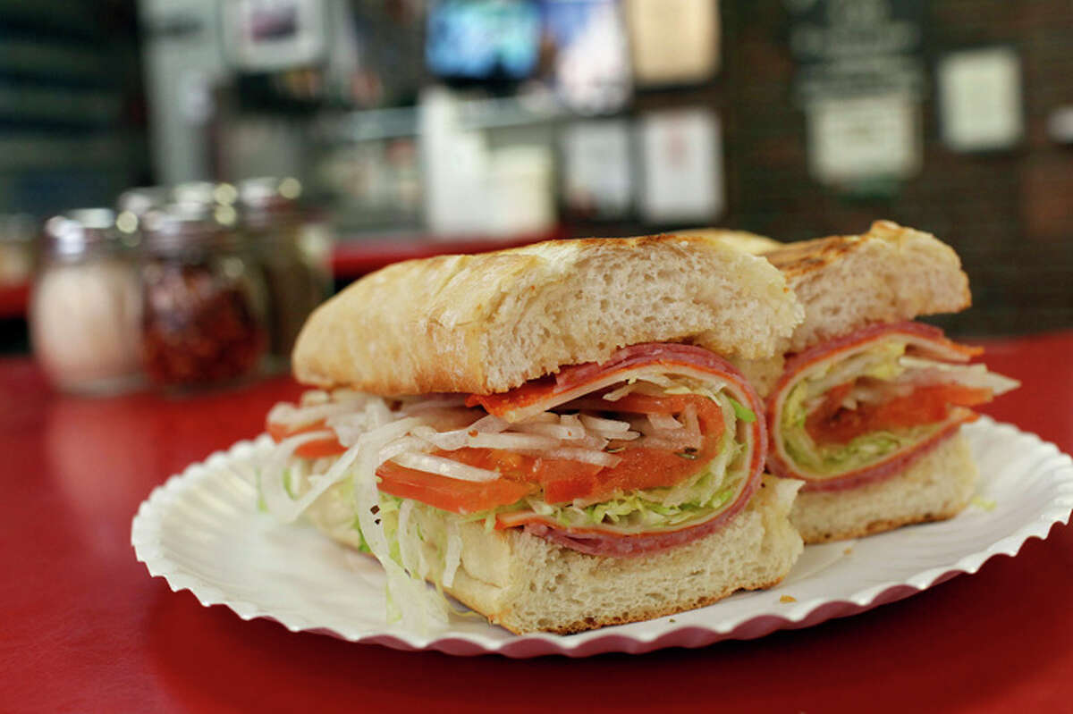 The Famous Cold Italian Hero is made of salami, ham pepperoni and provolone and served in a toasted roll.