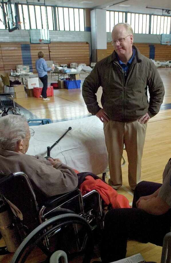Danbury Mayor Mark Boughton chats with Mary Jane Curtiss, of Brookfield, left, at the functional needs shelter set up at Bill Williams Gymnasium at Western Connecticut State University in Danbury on Thursday, Nov. 3, 2011. The shelter was set up for at-risk people who were discharged from a hospital and/or require constant medical care. Photo: Jason Rearick / The News-Times
