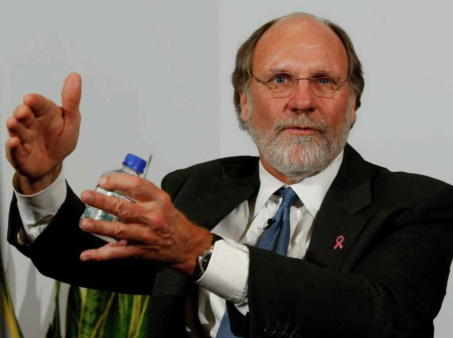FILE - In this Oct. 20, 2009 file photo, then New Jersey Gov. Jon S. Corzine answers a question during an interview with the Associated Press, in Trenton, N.J.  The firm, MF Global, said Friday, Nov. 4, 2011, Corzine has resigned as chairman and CEO and will decline payments from a severance package worth $12.1 million, including cash and benefits. (AP Photo/Mel Evans, File) Photo: Mel Evans / AP2009