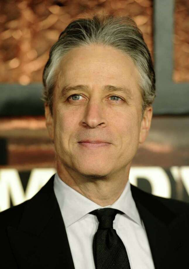 """FILE - In this March 26, 2011 file photo, TV personality Jon Stewart attends the first annual """"The Comedy Awards"""", honoring and celebrating the world of comedy, in New York. With Election Day 2012 looming a year away, Republicans trying to unseat President Obama are getting lampooned by late-night TV comics. (AP Photo/Peter Kramer, file) Photo: Peter Kramer"""