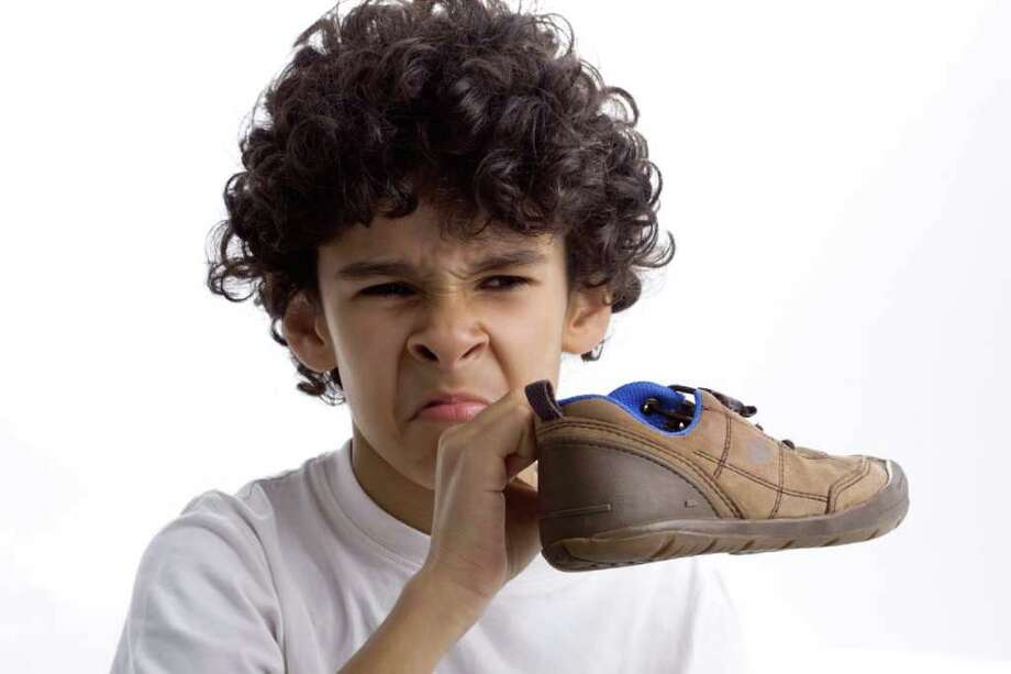 Kid with smelly shoe. / foradeprazo - Fotolia