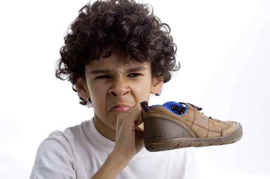 Kid with smelly shoe. / foradeprazo - Fotolia