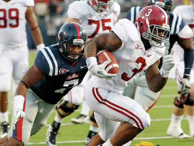 In this photo taken Oct. 15, 2011, Alabama running back Trent Richardson (3) stiff arms Mississippi defensive end Wayne Dorsey (7) as he runs for first half yards during their NCAA college football game in Oxford, Miss. Using a combination of power running and elusiveness, Richardson is threatening to outdo his former teammate and now NFL's New Orleans Saints tailback Mark Ingram with huge numbers and a Heisman-worthy run. Photo: AP