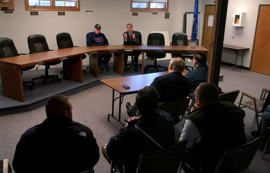 US Senator Richard Blumenthal, top right, meets with officials at Seymour Town Hall about the recent storm and resulting power outages in Seymour, Conn. on Friday November 4, 2011. At the senator's left is Seymour First Selectman Paul Roy. Photo: Christian Abraham / Connecticut Post