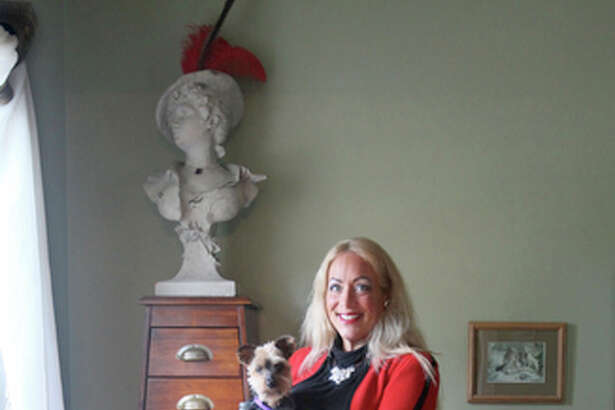 """Sharon Kreighbaum offers decluttering advice in her new book """"Is Your House Overweight?"""" Here, she poses for portrait October 20, 2011, at her home in Hudson, Ohio."""