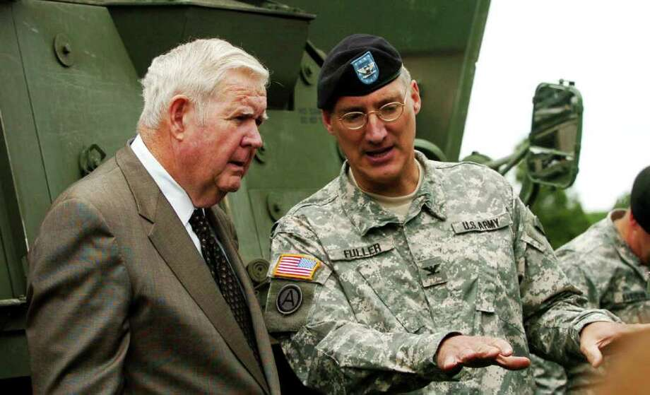 FILE - In this June 10, 2006 file photo, U.S. Rep Jack Murtha, D-Pa., left, and Col. Peter Fuller inspect the new Pennsylvania National Guard Stryker armored vehicles that were rolled out to the public at Fort Indiantown Gap, Pa. Gen. John Allen said Maj. Gen. Peter Fuller has been relieved of his duties as deputy commander for the Afghan training mission. In a recent interview with the website Politico, Fuller characterized Afghan leaders as erratic, ungrateful and isolated from reality. The interview quotes him as saying Afghan leaders don't fully recognize America's sacrifices on their country's behalf.  (AP Photo/Bradley C. Bower, File) Photo: BRADLEY C BOWER / AP2006