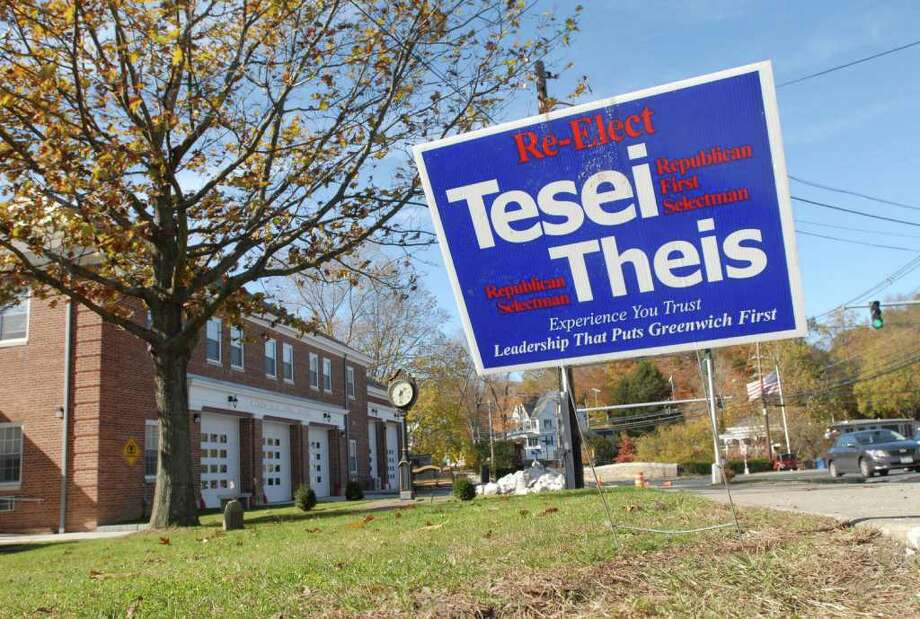 A sign in front of the Glenville Fire Station, Friday afternoon, Nov. 4, 2011, urges voters to re-elect Republican First Slectman Peter Tesei and Selectman David Theis. Town Democrats have alleged that their party's signs have been taken down and replaced with those for GOP candidates in various locations around town. Photo: Bob Luckey / Greenwich Time