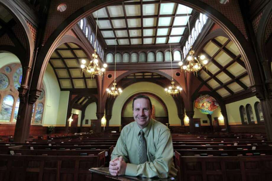 Michael Lister, Assistant Professor of Choral Music at the College of Saint Rose and music director of First Presbyterian Church of Albany, stands inside of the church on Thursday  Nov. 3, 2011 in Albany, NY.  Dr. Lister will be conducting a joint concert with Maury Castro, music director of First United Church of Troy, on Sunday. (Philip Kamrass / Times Union ) Photo: Philip Kamrass / 00015261A
