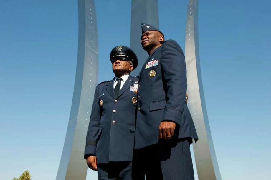 MARVIN JOSEPH : WASHINGTON POST LIFELONG SERVICE: Maj. Gen. Alfred Flowers, left, who is retiring from the U.S. Air Force, visits the Air Force Memorial with his son Lt. Col. Alfred Flowers Jr. The elder Flowers has served in the Air Force since 1965. Photo: POST / WASHINGTON POST