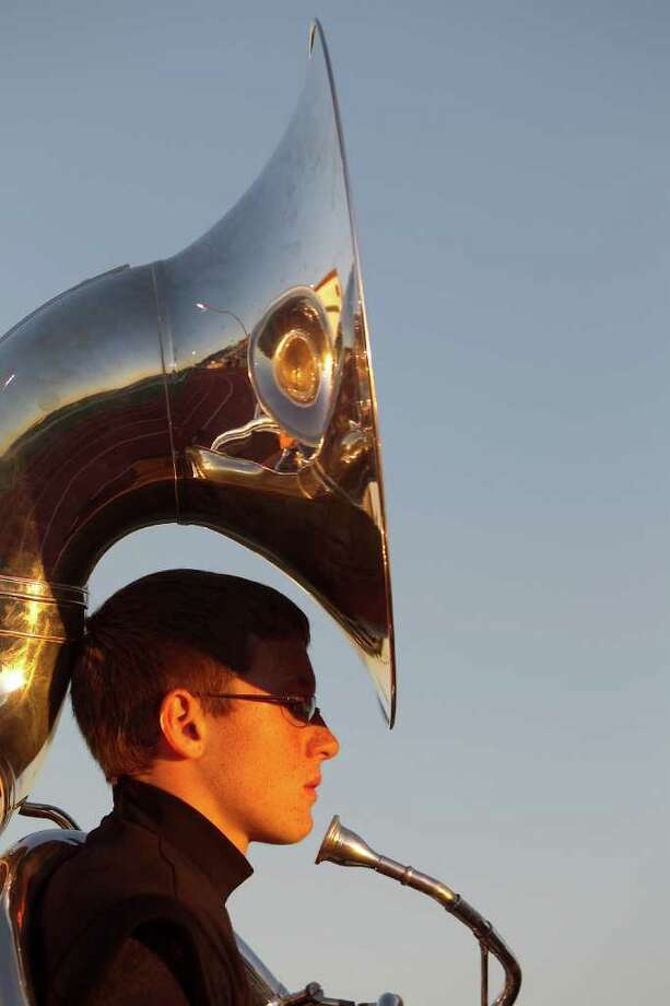 Wesley Hamilton, of the Dawson High School marching band stands in line before a 24 4A high school football game between Manvel and Dawson High Schools, Friday, Nov. 4, 2011, at The Rig in Pearland. Photo: Nick De La Torre, Houston Chronicle / © 2011  Houston Chronicle